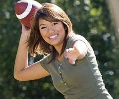 Woman throws out first football to commemorate start of new season......